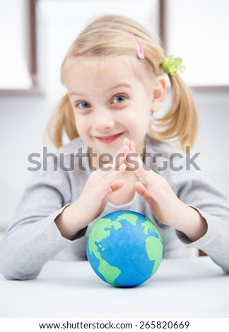 save the earth concept with smile girl - stock photo