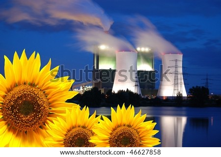 save the nature concept with sunflower and oil power plant - stock photo
