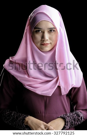 Save to a lightbox  Find Similar Images  Share Stock Photo: Fashion portrait of young beautiful muslim woman with maroon costume wearing pink color hijab isolated on black background - stock photo