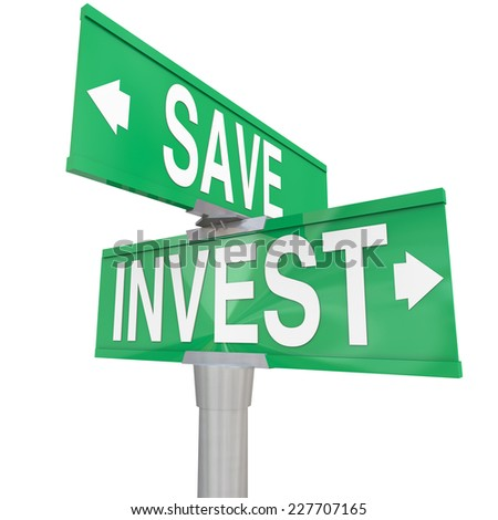 Save Vs Invest words on two way road or street signs with arrows pointing the way to different investment or savings choices to grow your portfolio or assets for retirement - stock photo