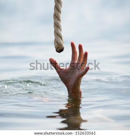 saving a drowning man  - stock photo