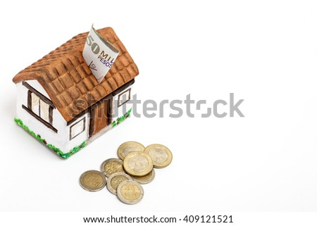 Saving colombian money for a new house - high angle - stock photo