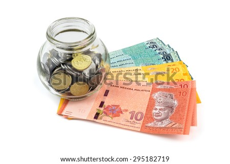 Saving concept. Banknotes and coins with a glass container isolated on white background.