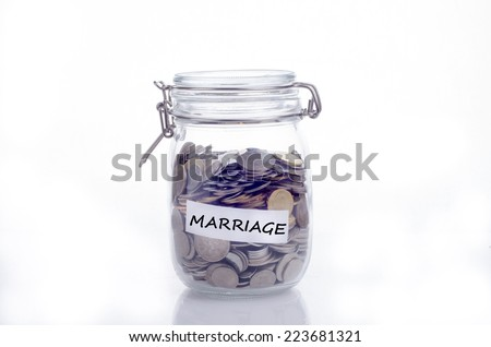 Saving concept for marriage: Conceptual by jar with coin