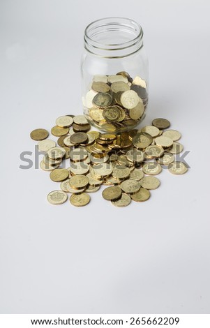 Saving Concept. Gold coins with bottle