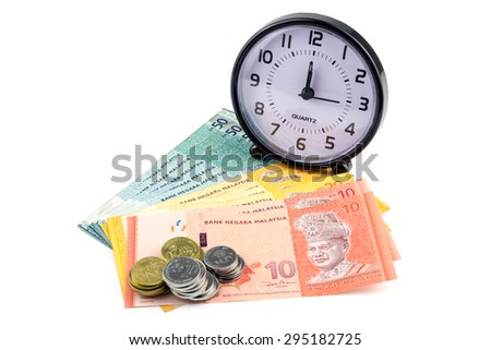 Saving concept. Stacks of banknotes and coins with clock isolated on white background