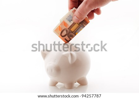 Saving fifty euro in money box