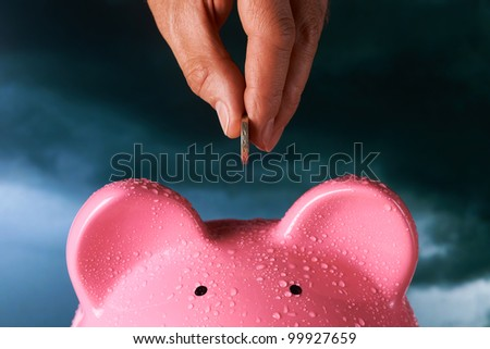 Saving for a rainy day piggy bank saving concept - stock photo
