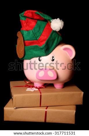 Saving for christmas piggy bank elf cutout - stock photo