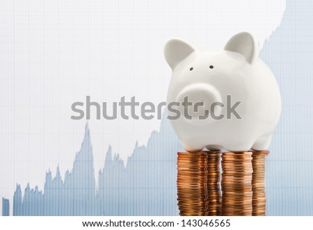 Saving growth line graph with piggy bank - stock photo