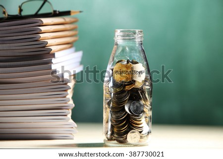 saving jar with coin for eduction - stock photo