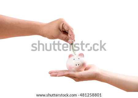 Saving, male hand putting a coin into piggy bank.