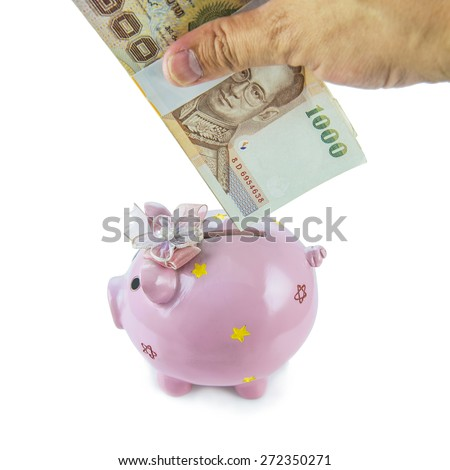 Saving, male hand putting a money into piggy bank isolated on white background. - stock photo