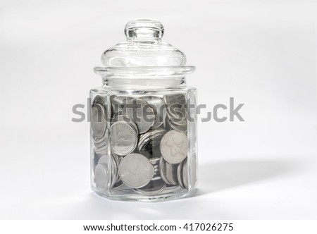 Saving money - a concept. UAE dirham coins in a glass bottle. - stock photo