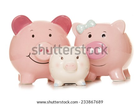 saving money as a family piggy banks cutout - stock photo