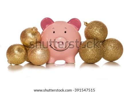 Saving money at christmas piggybank studio cutout - stock photo