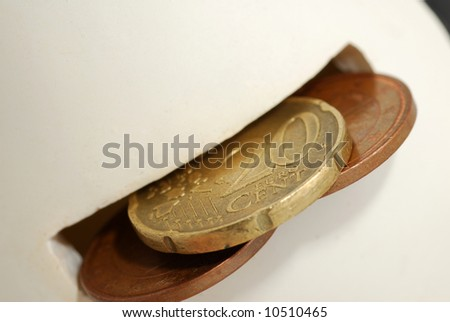 Saving money (coins) for later. - stock photo