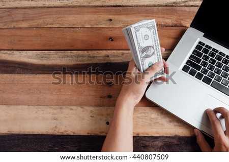 Saving money concept,Investment,Business man hand putting money  - stock photo