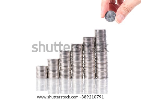 Saving money. female hand putting coin growing in each columns from left to right  isolated on white background - stock photo