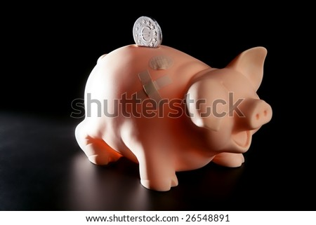 Saving money in crisis time, wounded piggy bank - stock photo