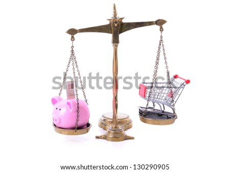 Saving on shopping concept piggy bank and shopping cart on scales