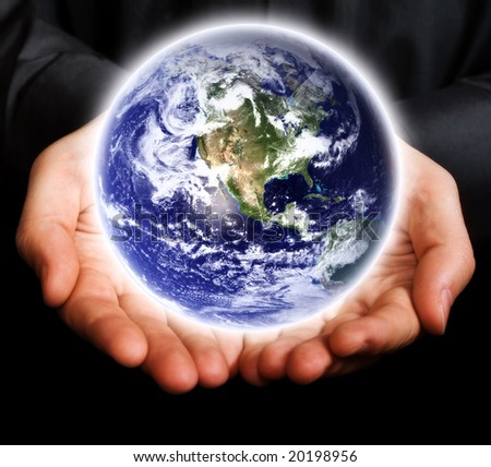 Saving the Earth concept: human hands holding the planet - stock photo