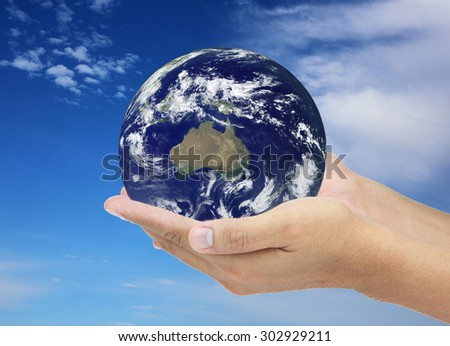 Saving the World on blue sky. Elements of this image furnished by NASA