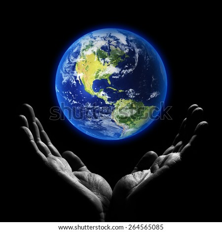 Saving world. Elements of this image furnished by NASA - stock photo