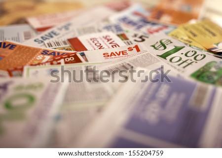 Savings coupons, Tilt to get off details   - stock photo