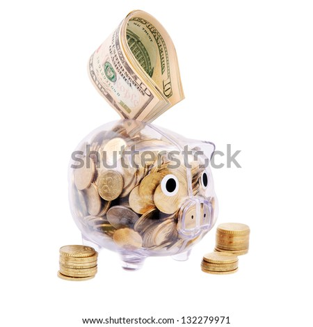 Savings in piggy bank isolated on the white background - stock photo