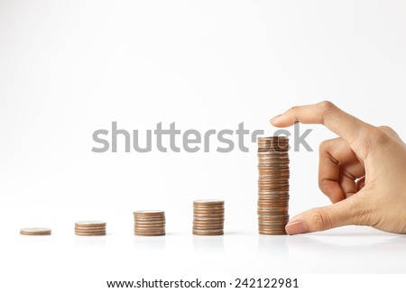 Savings, increasing columns of  coins with white background and asian handle