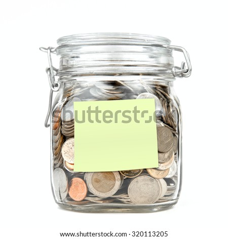 Savings money box coins thai baht with empty green stick note paper isolated on white background. Jar for savings full of coins. Piggy bank for saving money template for text. Close up. Front view. - stock photo