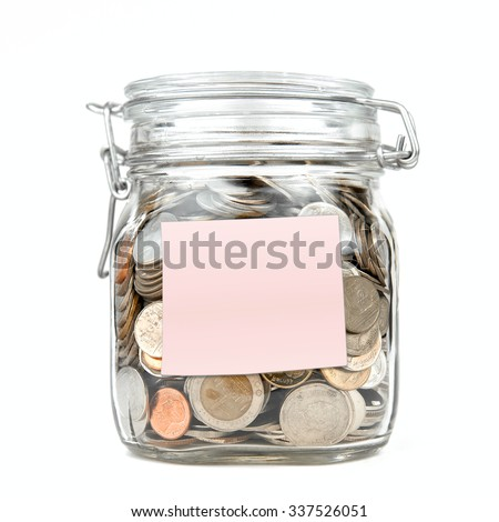 Savings money box coins thai baht with empty pink stick note paper isolated on white background. Jar for savings full of coins. Piggy bank for saving money template for text. Close up. Front view. - stock photo
