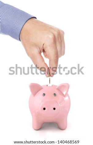 Savings - Piggy bank and hand with coin, isolated on white - stock photo