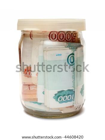 savings - russian money in glass jar - stock photo