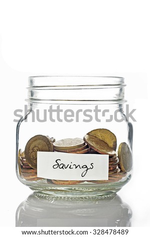 Savings with coins in a glass jar on white background - stock photo