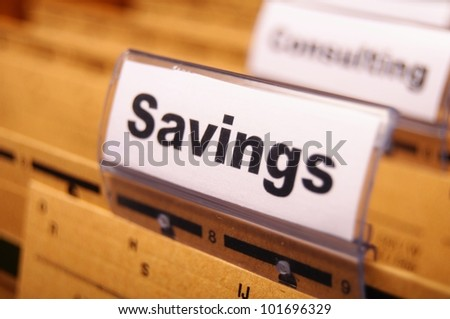 savings word on business folder showing saving money concept