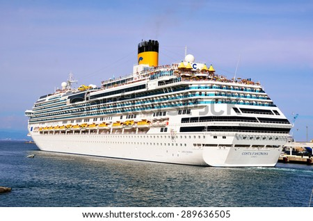 "SAVONA, ITALY - JUNE 21 cruise ship ""Costa Fascinosa"" leaves the port of Savona for a cruise in the Mediterranean, June 21 2015 Savona Italy"