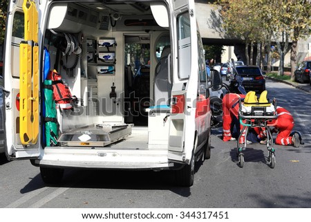 Savona, italy November 2015:breakdown service to a person injured by a car - stock photo