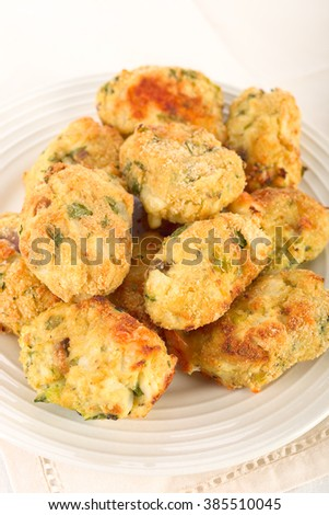 Savory cauliflower nuggets with cheese and parsley.