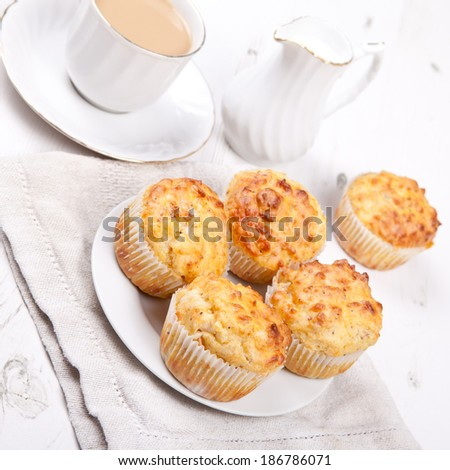 Savory cheese and bacon muffins with coffee on the white wooden table - stock photo