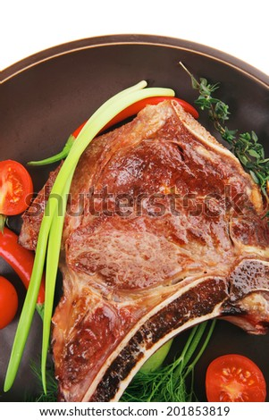 savory : grilled spare rib on dark dish with thyme pepper and tomato isolated over white background - stock photo