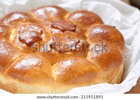 Savory meat pie with stuffed buns on a table - stock photo