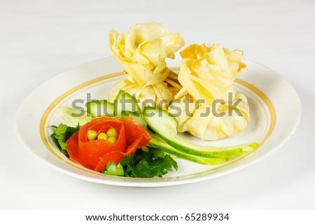 Savory pancake like cake filled with mushrooms and ham - stock photo