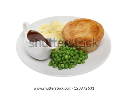 Savory pie with mashed potatoes, peas and gravy in a jug on a plate isolated against white - stock photo