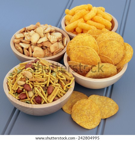 Savory snack party food selection in wooden  bowls. - stock photo