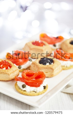 Savoury holiday appetizers on plate - stock photo