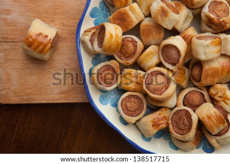 Savoury rolls sliced oven baked in still life set - stock photo