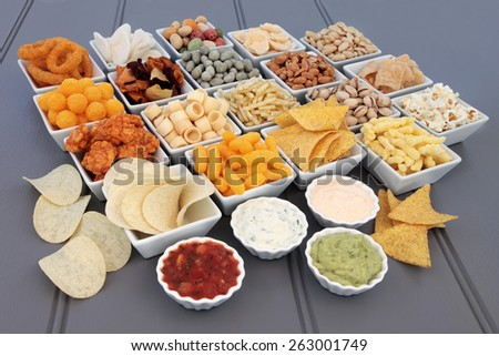 Savoury snack and dip food selection in porcelain dishes. - stock photo