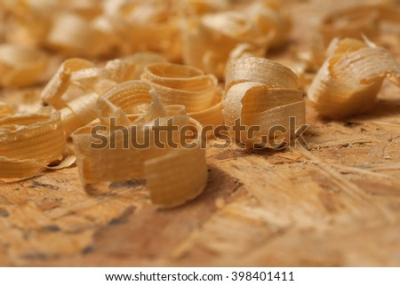 Saw blade and sawdust shot on grainy pine.  Carpenter workplace top view. - stock photo